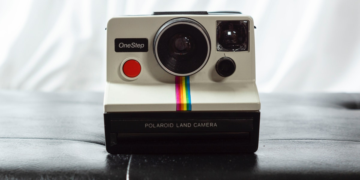 Classic Polaroid camera on a counter